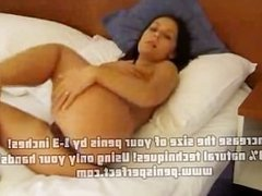 Amateur brunette masturbating on bed