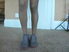 Ebony Athlete takes off her shoe and show her big feet