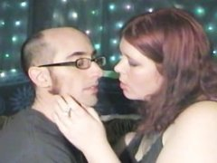 Young BBW french kissing her man while smoking