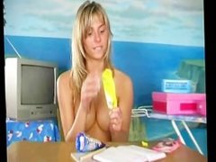 Blonde coed masturbates with an ice cream