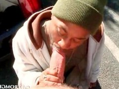 Interracial gay blowjob in public