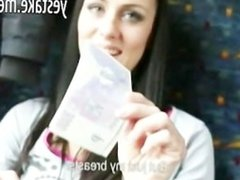 Brunette shows off in a traincompartment before giving head