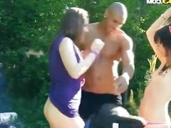 Interracial threesome in outdoors 1