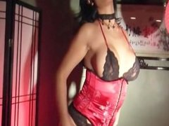 Glamour babe masturbates in a corset sexy high heels and stockings