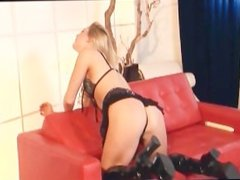 Skinny blonde masturbates in shiny knee high boots a bra and panties