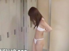 Asian hotties undressing in locker room