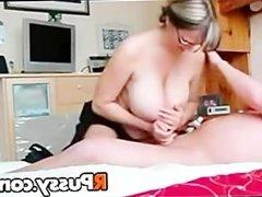 Big breasted MILF gives nice handjob