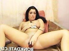 Horny brunette toys her pussy on webcam