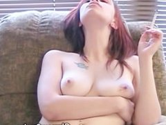 Hot red head strips while smoking