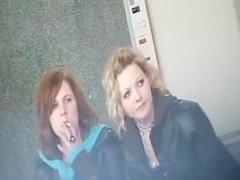 2 Girls Smoking on a Bench