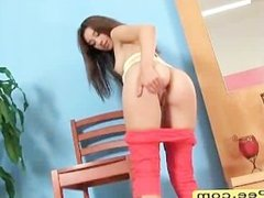 Passionate petite teen babe peeing on chair