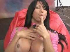This solo latina jerks her cock off while alone