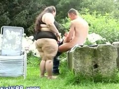Fat slut takes his cock for a blow in her yard