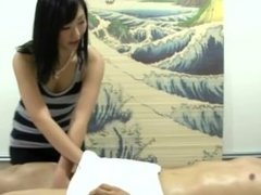 Masseuse gets busy with her clients hard dick during his session