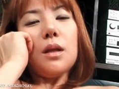 Redhead hot asian strips and rubs pussy on the couch