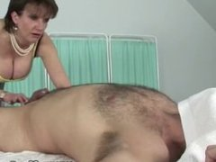Big titted mature hottie oiling up cock