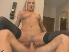 This sexy blonde babe is riding on a big cock