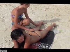 Lesbian amateur gets a hot body massage at the beach