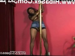 Black girl dances on the pole in fishnet lingerie