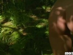 Petite european chick peeing in a forest