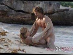 cute art sex of horny couple on beach