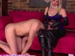 Domina teases her slaves with hands and mouth during session