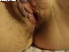 Mature working her pussy hard on webcam