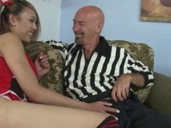 Oriental cheerleader gives BJ and titjob