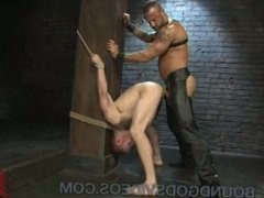 Bound to a pillar gay gets fucked