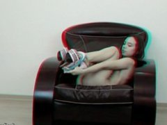 Teen small breasted model posing on an armchair