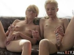 blond babes dildoing together on a sofa