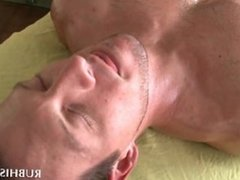 Gay masseur giving handjob to his horny client
