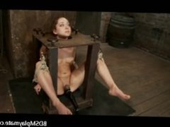 A sub girl bondaged, throatfucked and a clit tortured