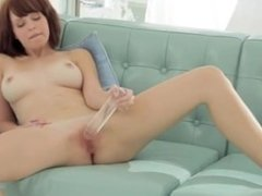 Glass toy in shaved pink vagina