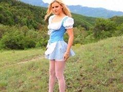 Blonde model teasing outdoor in forest