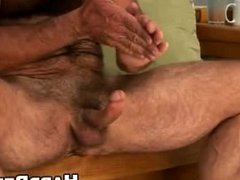 Older hairy stud rubs his hard cock while standing up