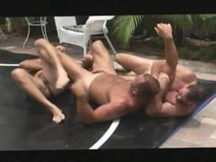 A hot threesome of studs fuck after they wrestle
