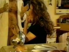 Retro babe sucks cock in the kitchen