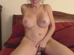 Forcing a large dildo in her pussy