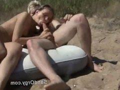 Wild swingers fuck on public beach
