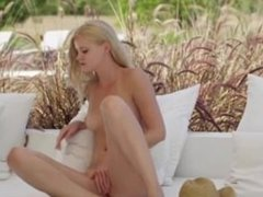 Blonde beauty rubbing hole in fields