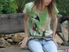 Ultra skinny girl pose on a bench
