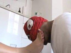 Spiderman licks feet