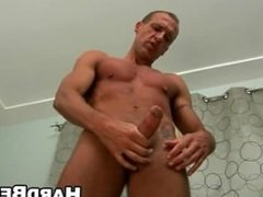 He is a hot stud who is jerking his big cock off