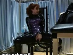 Smothering Fetish Girl In Latex Costume Caned