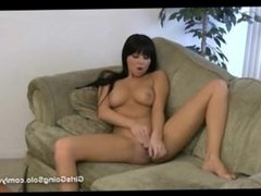 Chloe james playing with dildo on the sofa