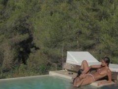 blackhair lesbians make love in the pool