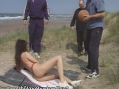 Three guys fuck a hairy pussy woman outside on the beach