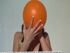 Teen blows up balloons till they pop in her face