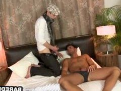Horny hunk sucking and tugging on a stiff cock